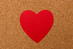 Red heart on pressured cork background. Love heart on pressured cork texture background, valentines day card concept Stock Photography
