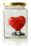 Red heart protected in a jar Stock Image