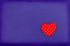 Red heart on purple leather vintage background Royalty Free Stock Image