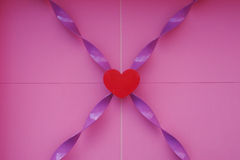 Red heart with purple twist Stock Images