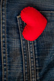 Red Heart put on an old blue jeans. Means love for denim. Stock Images