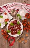 Red heart r.avioli with tomato, mozzarella and basil stock image