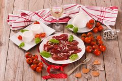 Red heart r.avioli with tomato, mozzarella and basil royalty free stock images