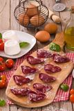 Red heart r.avioli with tomato, mozzarella and basil. Red heart ravioli with tomato, mozzarella and basil on cutting board stock photography
