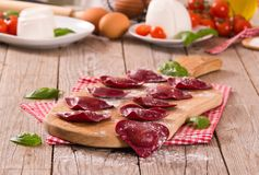 Red heart ravioli with tomato, mozzarella and basil. royalty free stock photos