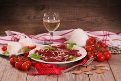Red heart r.avioli with tomato, mozzarella and basil royalty free stock image