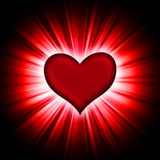 Red heart with rays on a black Stock Image