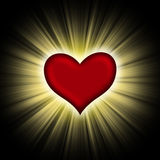 Red heart with rays on a black Stock Photo