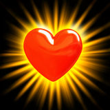 Red heart in the rays of light Royalty Free Stock Photo