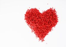 Red heart from recycled materials, paper through shredder, the second life of things