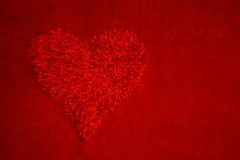 Red  heart on red  background Stock Photo