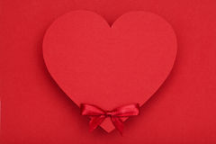 Red heart and red bow Stock Image