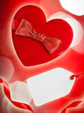 Red heart with red bow and blank tag Stock Photography