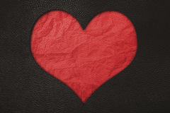 Red heart, red crumpled leather and black leather texture background. Red heart,red crumpled leather and black leather texture background Stock Image