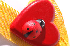 Red heart and ribbon. Red heart with yellow ribbon and ladybug Royalty Free Stock Image