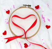 Red heart ribbon isolated on embroidery hoop Royalty Free Stock Photography