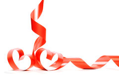 Red heart ribbon isolated on white background. Studio shot stock photos