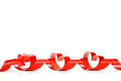 Red heart ribbon isolated on white background. Studio shot stock photography
