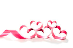 Red heart ribbon isolated on white background. Studio shot royalty free stock images
