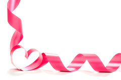 Red heart ribbon isolated on white background. Studio shot royalty free stock photography