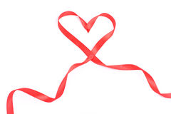 Red heart from ribbon for valentine. Isolated over white Stock Photo