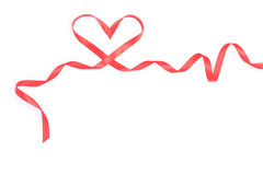 Red heart from ribbon for valentine. Isolated over white stock images