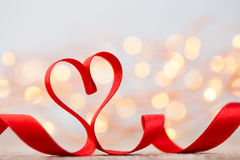 Red heart with ribbon. Valentines day background. Stock Photos