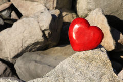 Red heart on rocks Royalty Free Stock Photography
