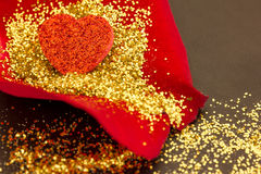 A red heart on a rose petal Royalty Free Stock Image