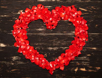 Red heart from rose petals Royalty Free Stock Photography