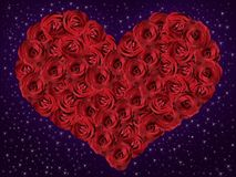 Red heart from roses. Red heart of roses on a radiant blue background Royalty Free Stock Photo