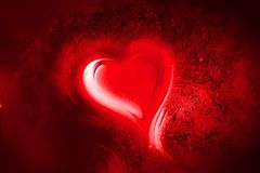 Red heart in rough background stock photography