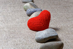 Red heart in row of stones Stock Photos
