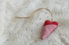 Red heart on Russian downy shawl Royalty Free Stock Photography