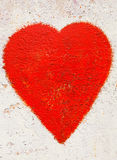 Red heart on  rusty background Stock Image