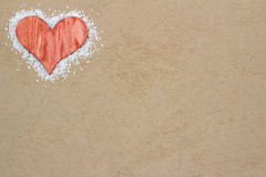 Red heart in the sand. Handmade red heart in the sand with copy space Royalty Free Stock Photos