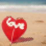 Red heart on a sand beach, triangle pattern. Vector illustration Royalty Free Stock Image