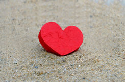 Red heart on the sand surface Royalty Free Stock Images