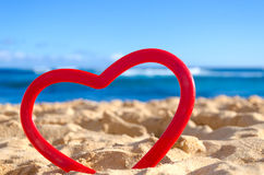 Red heart on the sandy beach background Royalty Free Stock Photography
