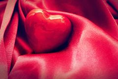 Red heart in satin cloth. Love background Royalty Free Stock Image