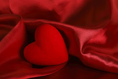 Red heart on satin Stock Image