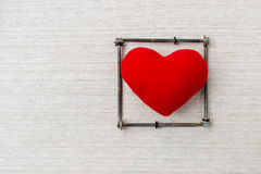 Red heart in screw frame. With space on canvas background, love in the frame Royalty Free Stock Image