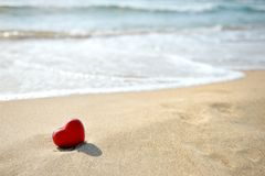Red heart on sea beach - love relax concept Royalty Free Stock Photography