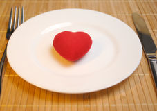 Red heart served on the plate Royalty Free Stock Photo