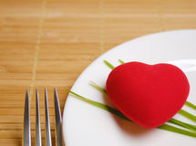 Red heart served on the plate Royalty Free Stock Images