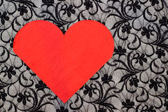 Red heart serviette on black lace Stock Photography