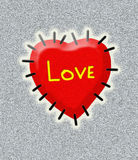 Red heart sewn to silver background Stock Images