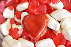 Red heart shape. Handmade red heart shape and the white stones Royalty Free Stock Image