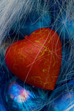 Red heart shape on blue crystals Stock Photos