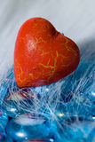 Red heart shape on blue crystals Royalty Free Stock Photos
